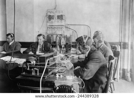 Students practicing telegraphy at the Marconi wireless school in New York City. Ca. 1912. - stock photo