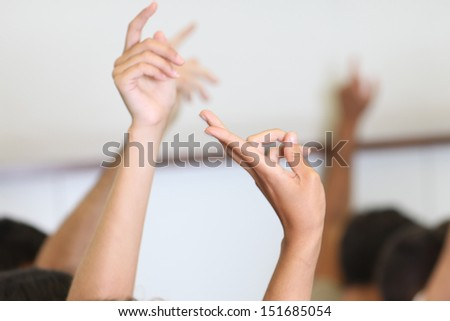 Students put hands up
