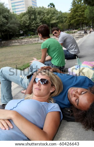 Students resting in park during summer