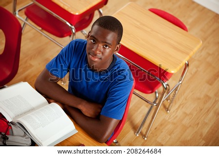 Students: Serious African American Teen Male At Desk In Class - stock photo