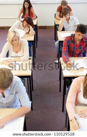 Students sitting exam - stock photo