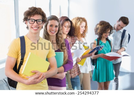 Students smiling at camera standing in a line at the college