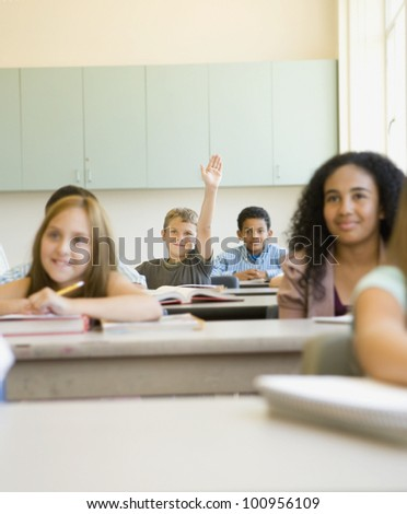 students smiling desks classroom stock photo royalty free