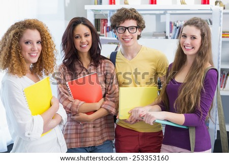 Students smiling at the camera at the college