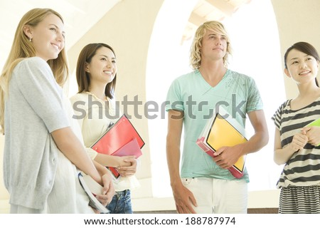 students standing still at hallway of school - stock photo