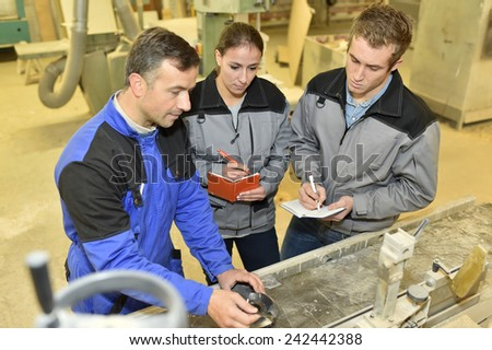 Students taking notes in workshop course - stock photo