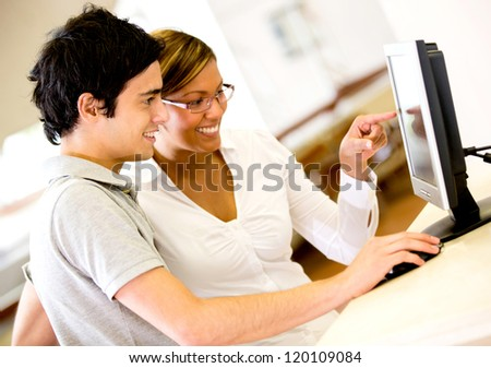 Students using a computer at the university - stock photo