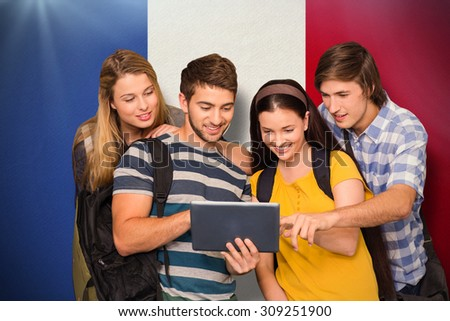 Students using digital tablet at college corridor against france national flag - stock photo