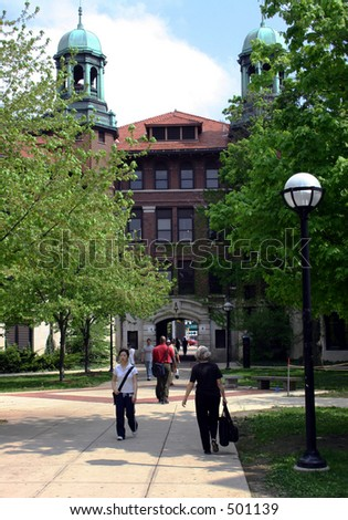 Students walking through Diag on the University of Michigan campus - stock photo