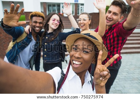 students with beaming smiles are posing for selfie shot