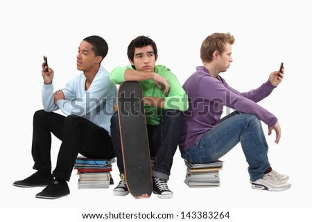 Students with books and a skateboard - stock photo