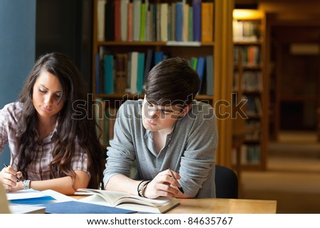students writing essay library stock photo shutterstock students writing an essay in a library