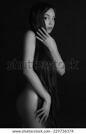 Studinnoe black and white photo of a young woman in an elegant style. - stock photo
