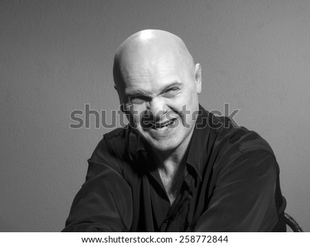 Studio black and white portrait caucasian bald men. Emotions. anger - stock photo