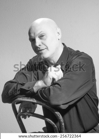 Studio black and white portrait portrait caucasian bald men. Emotions. Ironic