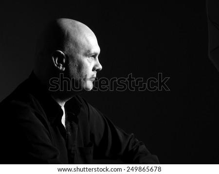 Studio black and white portrait portrait caucasian bald men. Emotions. Serious - stock photo