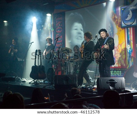 STUDIO CITY, CA - JAN 28: Tim Piper (2nd R) performs as John Lennon at The Platinum theatre on January 28, 2009 in Studio City, California. - stock photo