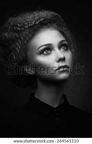 Studio classic portrait of beauty woman with creative make-up and hairstyle. Black and white - stock photo