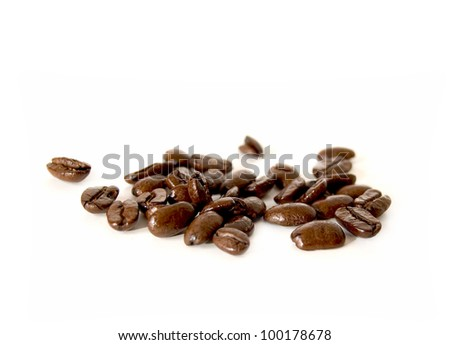 Studio close up of fresh coffee beans on a white background. Copy space. - stock photo