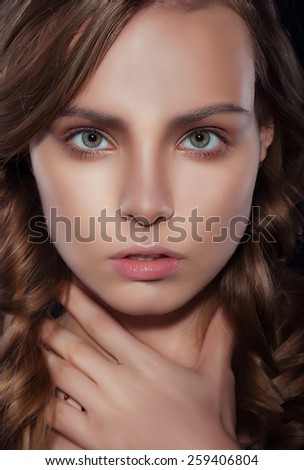 Studio Close Up Portrait of Young Woman - stock photo
