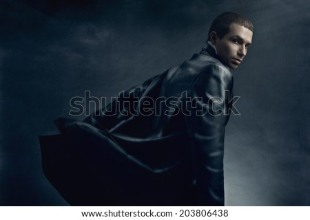 Studio fashion of young handsome man in leather coat.