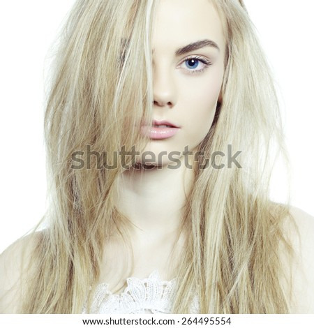 Studio fashion portrait of young beautiful lady on white background