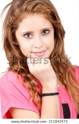 Studio fashion portrait of young beautiful smiling girl with nice eyes on white background