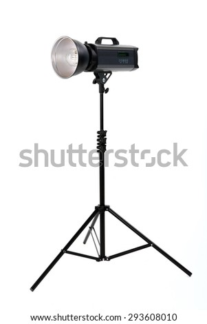 studio flash on a stand with isolated background