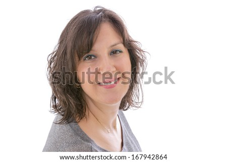 Studio head and shoulders portrait over white, of a smiling brunette woman looking directly to the camera. - stock photo