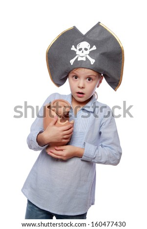 Studio image of a charming emotional little girl with a sweet smile as evil pirate in a pirate hat isolated on white on Holiday - stock photo