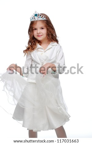 Studio image of beautiful little girl in white princess dress with long curly blond hair/Lovely young princess over white