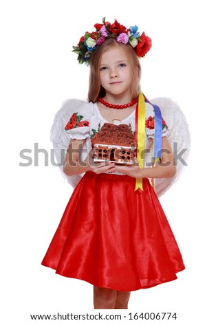 emotional lovely little angelic girl in a beautiful national Ukrainian ...