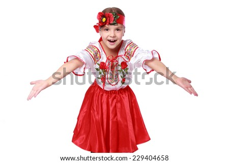 Studio image of emotional lovely little girl in a beautiful national Ukrainian suit isolated on a white background on Holiday