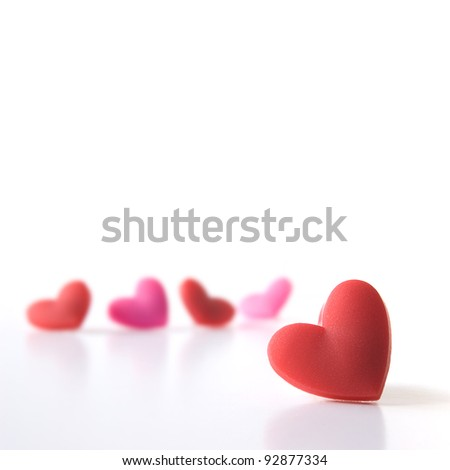 Studio image of five Valentine hearts with focus on the foreground. Isolated on white. 21 x 21 cm crop. Copy space. - stock photo