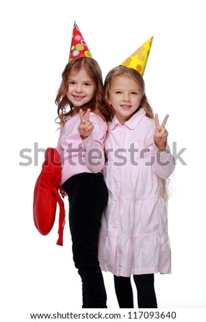 Studio image of laughing kids in party hats
