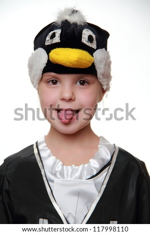 Studio image of little girl as a penguin on Holiday theme/Portrait of kid from costume party - stock photo