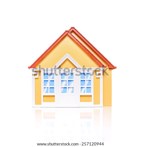 Studio image of modest 'first-time buyer' dwellings with white space and soft reflections. Copy space. Ideal for real estate or mortgage concepts. - stock photo