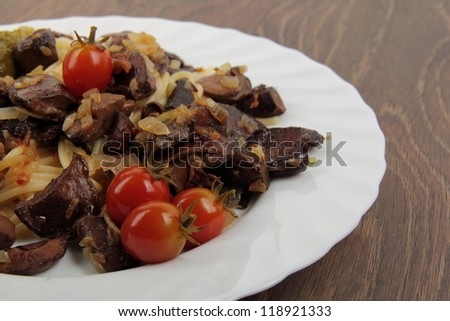 Studio image of pasta with mushrooms and small tasty tomatoes on Food and Drink theme