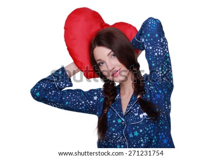 Studio image of sleeping romantic woman with red heart-shaped pillow on white background on Holiday theme