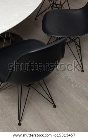 Studio interior with black chairs and round table