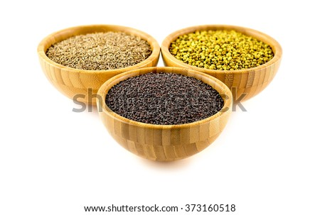 Studio isolated shot of bowls of spices, mustard in forground - stock photo