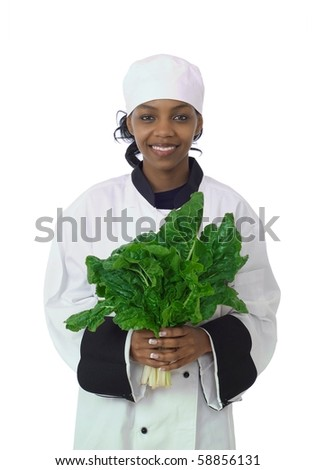 Studio isolated woman female chef and fresh green spinach vegetable - stock photo