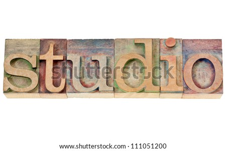 studio  - isolated word in vintage letterpress wood type stained by color inks - stock photo