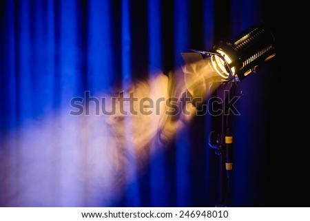 studio lamp on the blue background - stock photo
