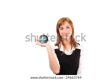 Studio lite shot of a business woman with a globe in her hand - stock photo