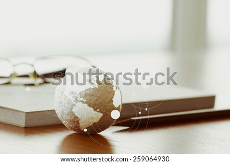Studio macro of a stethoscope and texture globe with digital tablet with shallow DOF evenly matched abstract as medical network concept Elements of this image furnished by NASA - stock photo