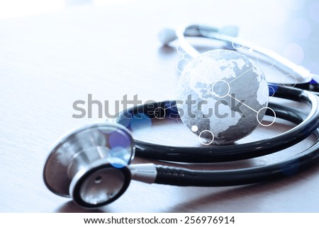 Studio macro of a stethoscope and texture globe with shallow DOF evenly matched abstract as medical network concept - stock photo