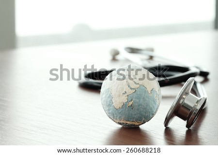 Studio macro of a stethoscope and texture globe with shallow DOF evenly matched abstract as medical network concept Elements of this image furnished by NASA - stock photo