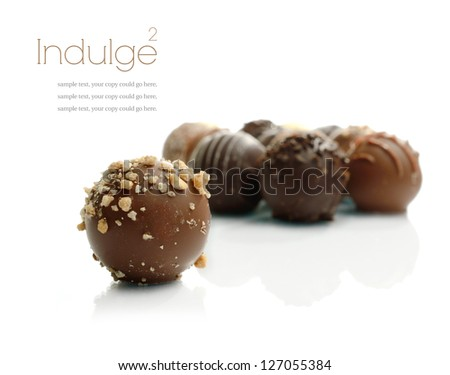 Studio macro of assorted delicious liqueur chocolates on a white background with soft shadows. Copy space. - stock photo