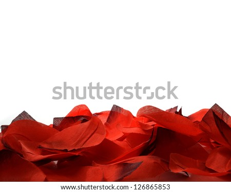Studio macro of red fabric leaves forming a lower border supporting your Valentine's Day or Mother's Day message. Copy space.